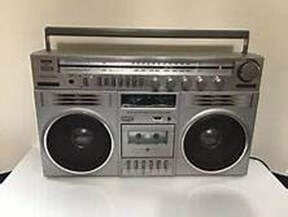 """Figure 1. Battery Hungry Portable Radio-Cassette Player from the 1980s. Called a """"Boom box""""."""