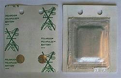 Figure 3. Flat and square Polaroid battery carefully removed from an empty film cartridge.