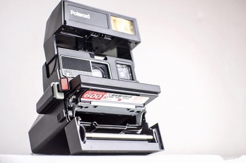 "Figure 2. 1980's Polaroid Camera showing a ""600"" film cartridge."